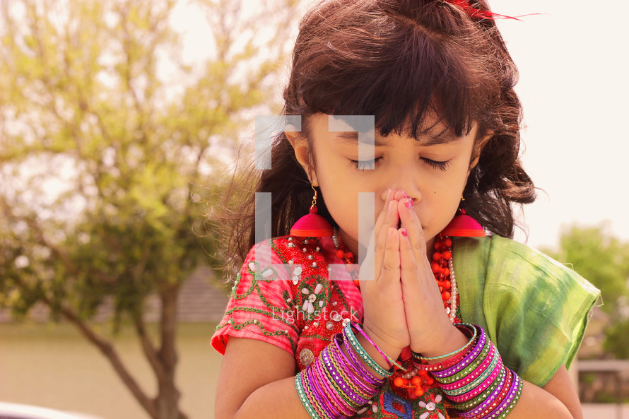 Cute girl praying
