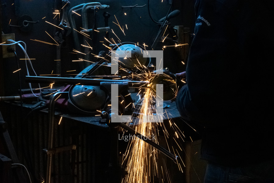 sparks from a mechanic working with metal