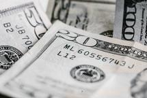 Close-up of dollar bills of different denominations.
