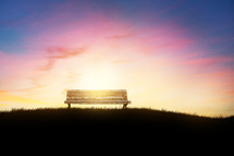 empty bench at sunset