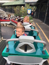 a family on a rollercoaster at Disneyland