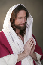 Jesus with praying hands.
