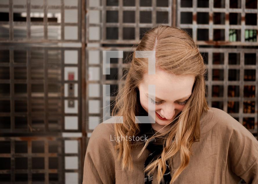 shy teen girl looking down