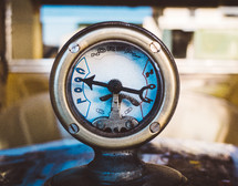 the thermostat gauge on an old vintage automobile