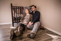 maternity portrait in a baby's nursery