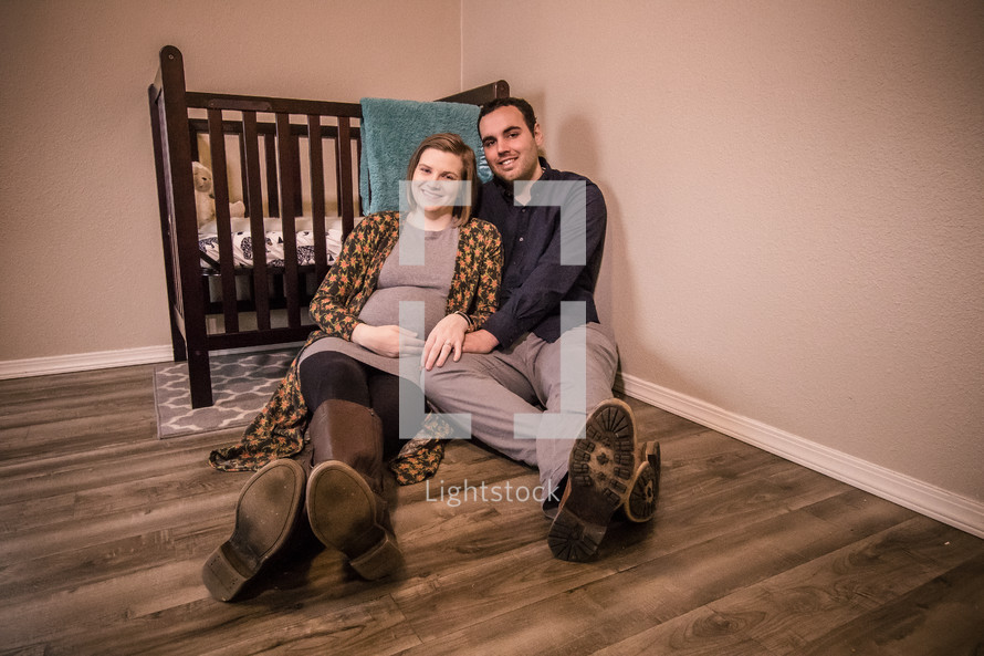 maternity portrait in a baby nursery