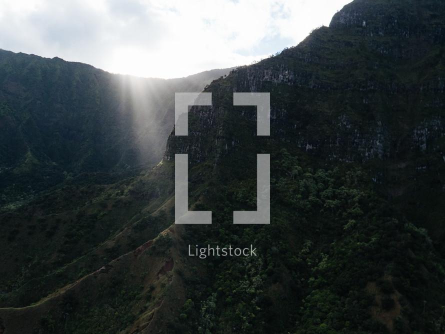 rays of sunlight on cliffs