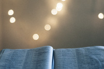 bokeh lights and an open Bible