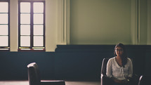 a woman sitting alone in a waiting room