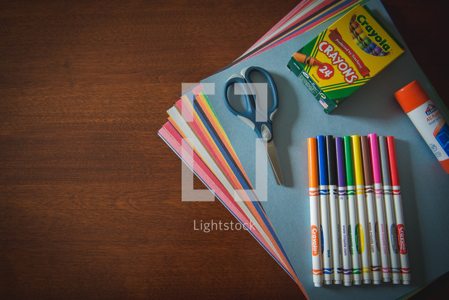 school supplies on a wood table