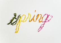 word spring in petals