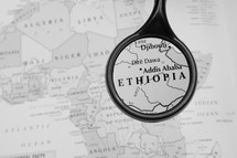 magnifying glass over a map of Ethiopia