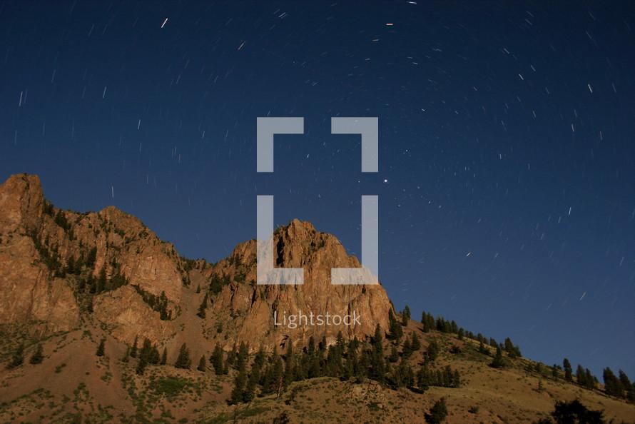 stars above the Rocky Mountain range.
