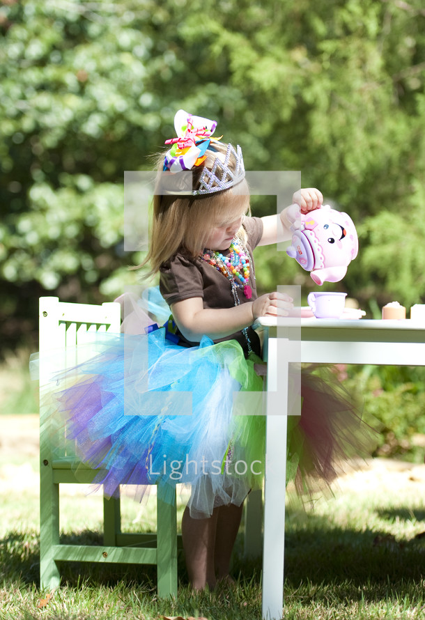 little girl having a princess tea party