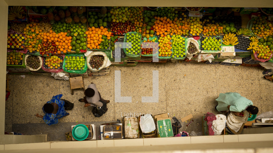 women and men in a farmers market in Rwanda