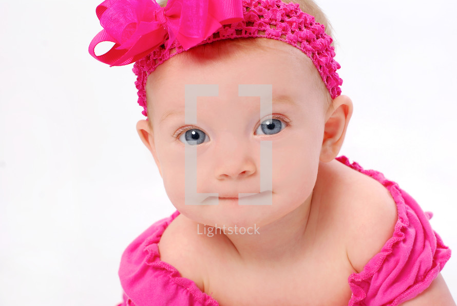 infant girl in fuchsia