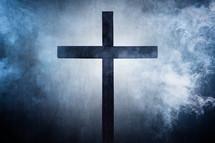 wood cross on smoky gray background