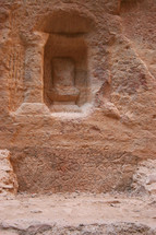 Niche and writing on a wall in Petra