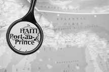 magnifying glass over a map of Haiti