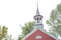 steeple on a red church