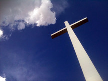 The Cross of Jesus Christ towering above the world against a clear blue sky among the clouds. It is the cross of Jesus that we can look to and be reminded of the hope that we have in Jesus Christ. We see this symbol and pass by it daily. My hope in sharing this photo is that it will bring light to the heart of anyone seeking the light of the world in the person of Jesus Christ,  God's only son who came down from Heaven and lived among us as a man and went to the cross for our sins.