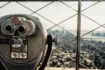 a viewfinder scope at the top of a skyscraper in NYC