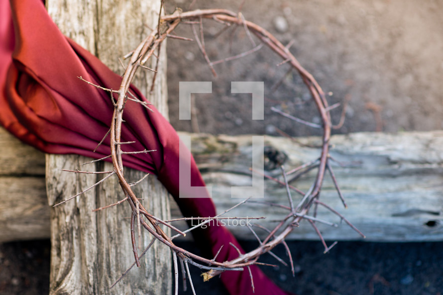 crown of thorns, red shroud, on a wood cross