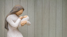 Figurine of Mary holding baby Jesus.
