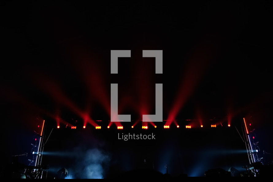 spotlights over a dark stage