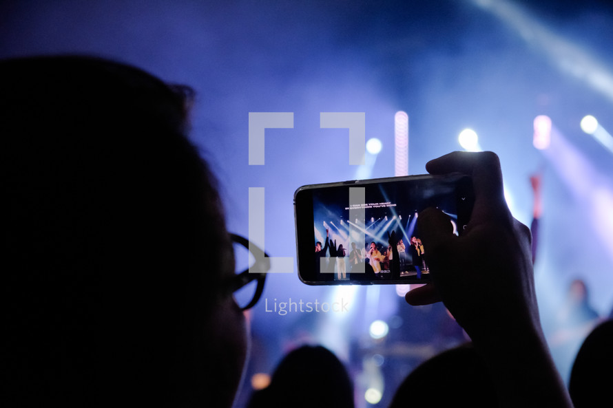 filming a concert on a cellphone