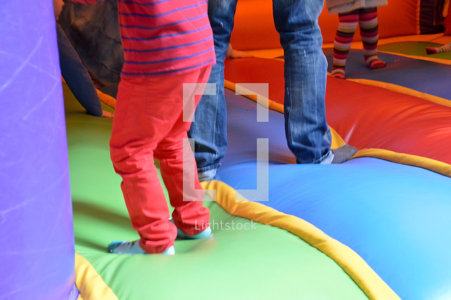 children bouncing in a bounce house. 
