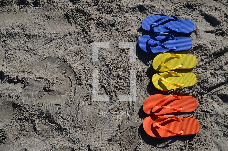 flip flops in the sand on the beach