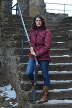 a woman standing on snowy steps