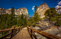 wood walking bridge and mountain peaks