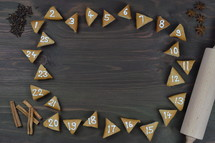 advent cookies on gray wood with rolling pin and spices