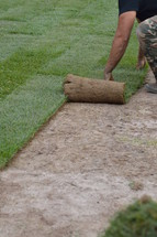a man laying sod