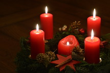Five candles are burning at the Advent wreath for Christmas Eve.  candlelight