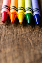 crayons on a wood background