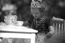 little girl having a princess tea party