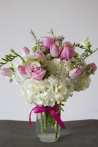 a vase of white and pink flowers