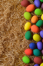 dyed Easter eggs on straw