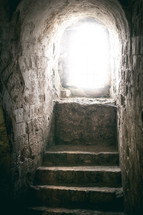 light shining on steps in a tomb
