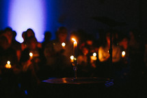 people holding candles at a vigil