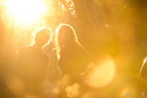 women under intense yellow sunlight