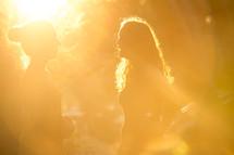 women under intense sunlight