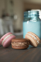 macaron cookies and a mason jar of milk