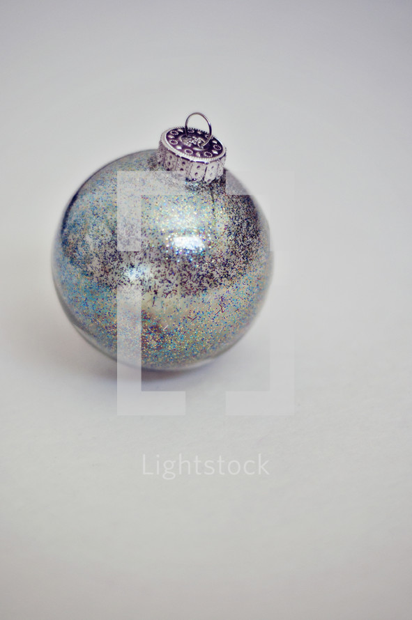 A silver Christmas ornament.