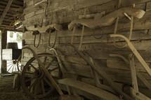 plows in a barn