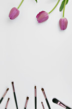 pink tulips and makeup brushes