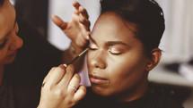 Makeup artist putting on makeup